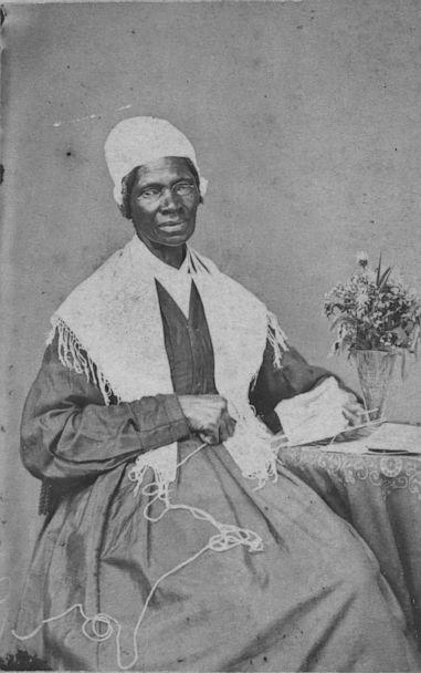 PHOTO: Abolitionist Sojourner Truth is seated at table holding yarn and a book, ca. 1864. (Library of Congress.)