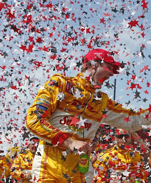 Ryan Hunter-Reay celebrates as confetti flies after he won the IndyCar auto race at the Milwaukee Mile in West Allis, Wis., Saturday, June 16, 2012. (AP Photo/Jeffrey Phelps)