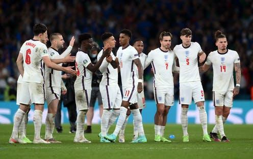 """<span class=""""caption"""">The England team reassure Marcus Rashford after he misses a penalty. </span> <span class=""""attribution""""><a class=""""link rapid-noclick-resp"""" href=""""https://webgate.epa.eu/webgate?EVENT=WEBSHOP_SEARCH&SEARCHMODE=NEW&SEARCHTXT1=&CS_MERGE=media"""" rel=""""nofollow noopener"""" target=""""_blank"""" data-ylk=""""slk:Laurence Griffiths/Pool"""">Laurence Griffiths/Pool</a></span>"""
