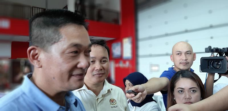 PKR's Batu Lintang State Assemblyman See Chee How speaks to reporters after handing fire extinguishers on behalf of the federal Ministry of Local Government and Housing to the state Fire and Rescue Department, November 23, 2019. — Picture by Sulok Tawie