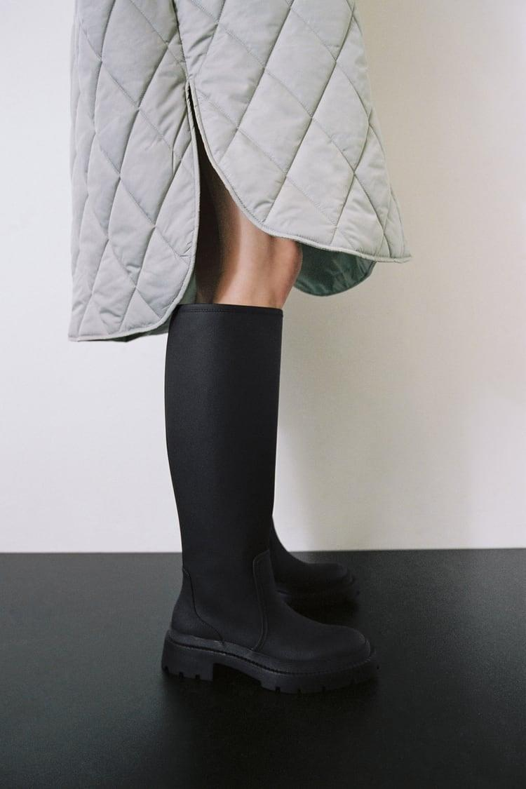 <p>TikTok users have been going crazy over these trending <span>Low Heel Rubberized Boots</span> ($80).</p>