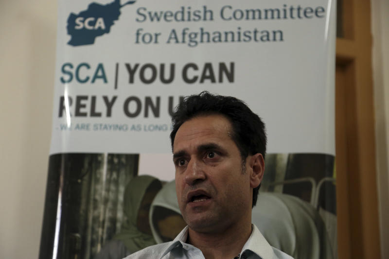 Ahmad Khalid Fahim, program director for the Swedish Committee for Afghanistan speaks during an interview with The Associated Press in Kabul, Afghanistan, Wednesday, July 17, 2019. The Swedish non-governmental organization in Afghanistan said the Taliban have forced the closure of 42 health facilities run by the non-profit group in eastern Maidan Wardan province. (AP Photo/Rahmat Gul)