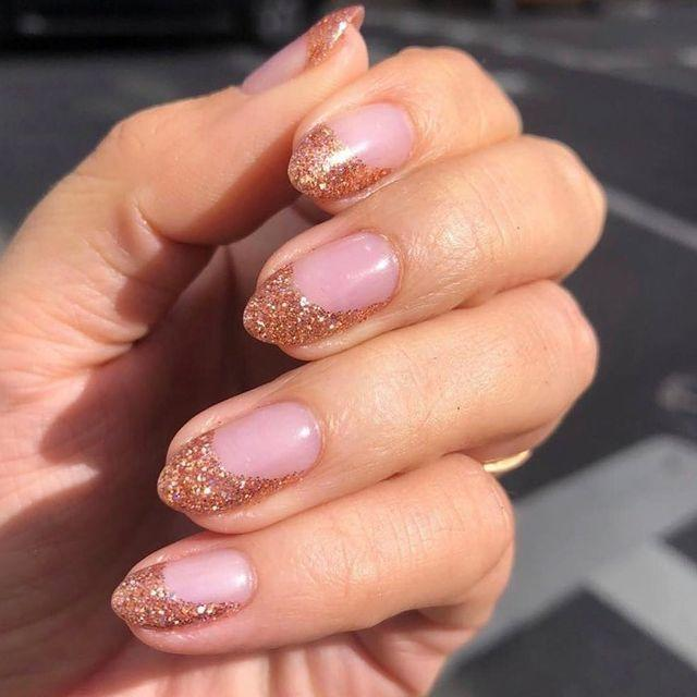 """<p>A rose gold glitter on top of a pink gel polish makes for the perfect #Nailfie.</p><p><a href=""""https://www.instagram.com/p/BzEtv-tAt1y/"""" rel=""""nofollow noopener"""" target=""""_blank"""" data-ylk=""""slk:See the original post on Instagram"""" class=""""link rapid-noclick-resp"""">See the original post on Instagram</a></p>"""