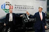 Kerry urges Taliban to follow Afghan warlord's peace deal