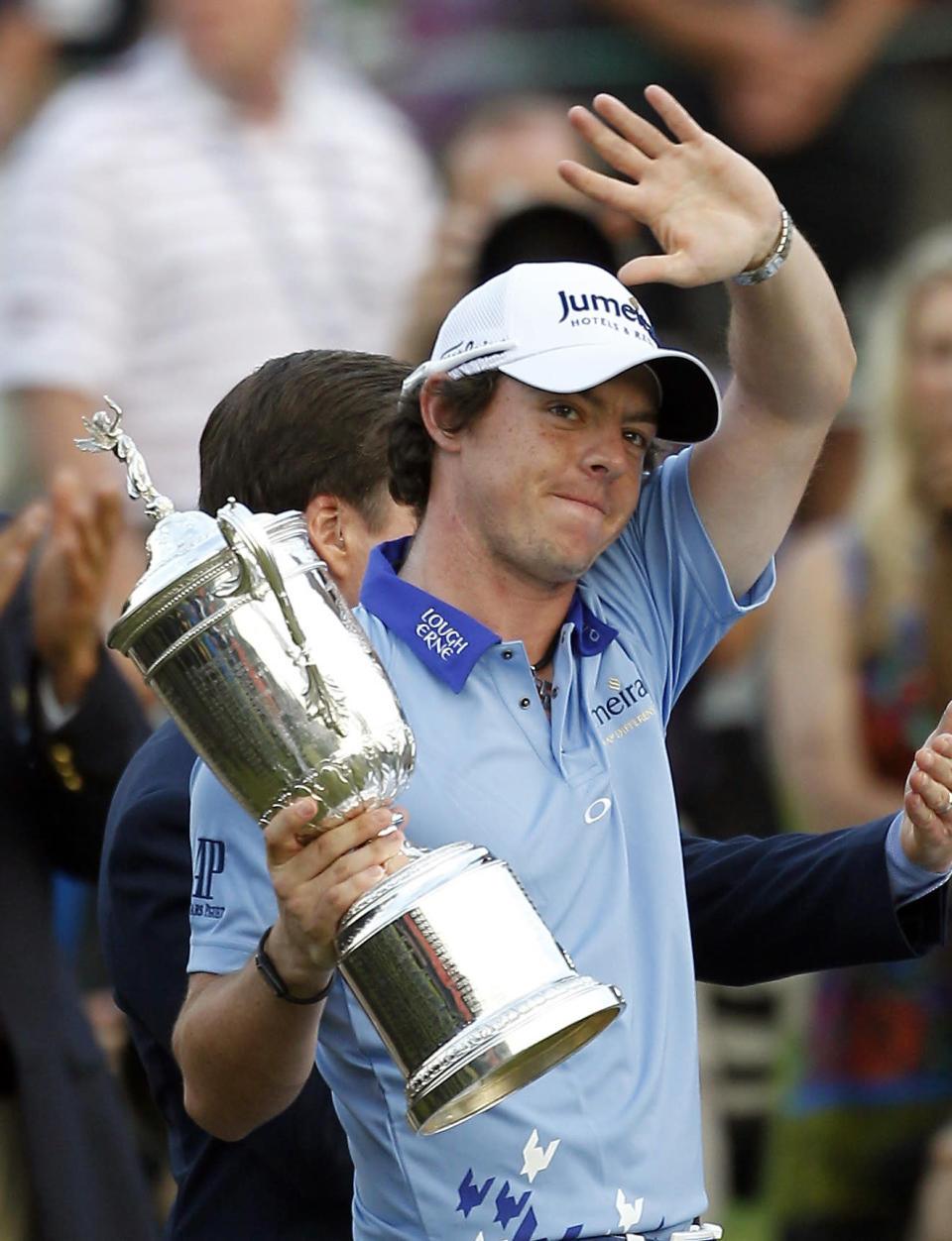 FILE - In this June 19, 2011, file photo, Rory McIlroy, of Northern Ireland, acknowledges the gallery as he holds the trophy on the 18th green after winning the U.S. Open Championship golf tournament in Bethesda, Md. Ten years ago, McIlroy won the first of his four majors. (AP Photo/Eric Gay, File)