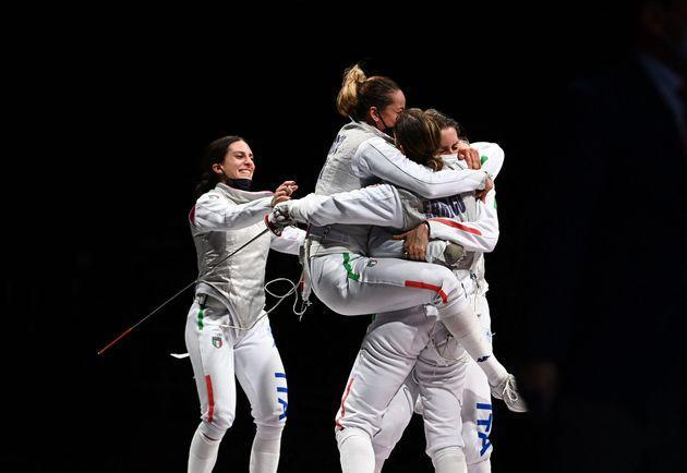 Italy's Arianna Errigo (R) celebrates with her teammates after winning against USA's Lee Kiefer in the women's foil team bronze medal bout during the Tokyo 2020 Olympic Games at the Makuhari Messe Hall in Chiba City, Chiba Prefecture, Japan, on July 29, 2021. (Photo by Mohd RASFAN / AFP) (Photo by MOHD RASFAN/AFP via Getty Images) (Photo: MOHD RASFAN via Getty Images)