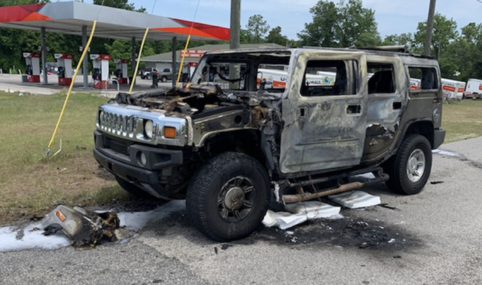 A burned out Hummer is pictured.