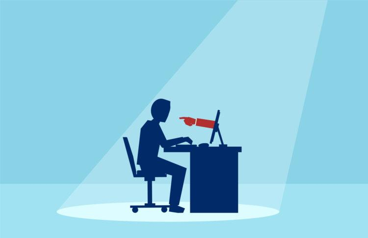 Vector of a business man working on computer with red hand finger pointing at him