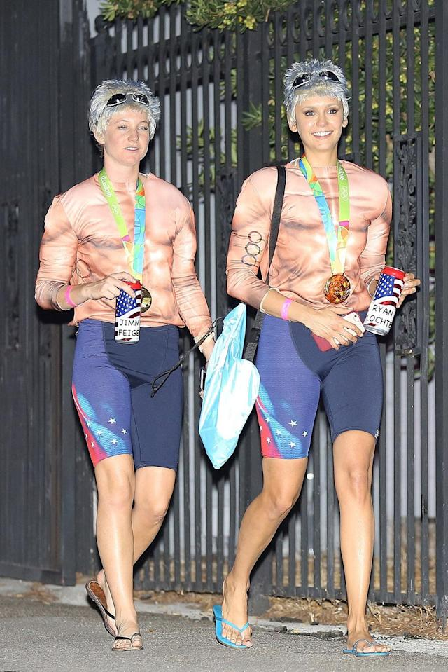 <p>Dobrev, right, had the same idea when she and a friend dressed as disgraced U.S. Olympic medalists Lochte and Jimmy Feigen. Hopefully, Taylor and Nina didn't show up to the same party! (Photo: AKM-GSI) </p>