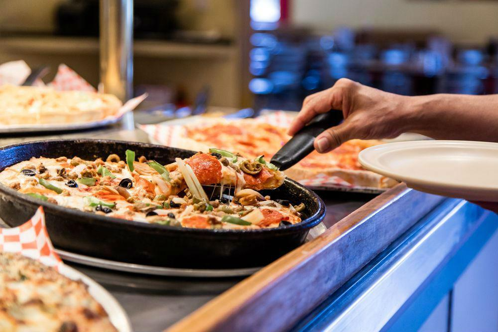 """<p>Pizza Inn was founded by two brothers in 1958 near Southern Methodist University's Dallas campus. Today there are more than 150 locations, mostly <a href=""""https://www.thedailymeal.com/cook/southern-recipes-to-try?referrer=yahoo&category=beauty_food&include_utm=1&utm_medium=referral&utm_source=yahoo&utm_campaign=feed"""">in the South</a>. A buffet-style approach allows guests to sample a wide array of pizzas, including the chain's crackery trademark original thin crust in varieties like chicken bacon ranch, bacon cheeseburger, taco, loaded baked potato and sweet """"Pizzert"""" dessert pies.</p>"""
