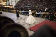 """<div class=""""caption-credit""""> Photo by: Getty Images</div>During the festivities, the bride holds the end of a long sash and stands perfectly still while rabbis, the groom's father, and some of her male relatives take turns holding the other end of the sash and dancing for her. The dances are considered a great honor."""