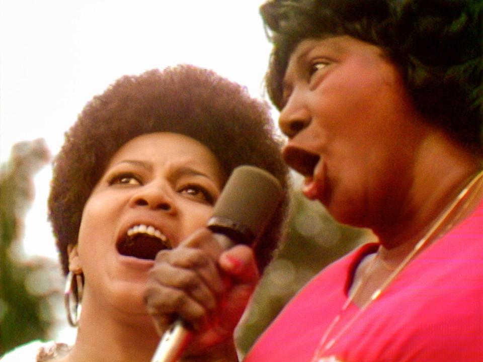 """The documentary """"Summer of Soul"""" showcases gospel legends Mavis Staples (left) and Mahalia Jackson performing """"Take My Hand, Precious Lord"""" at the 1969 Harlem Cultural Festival."""