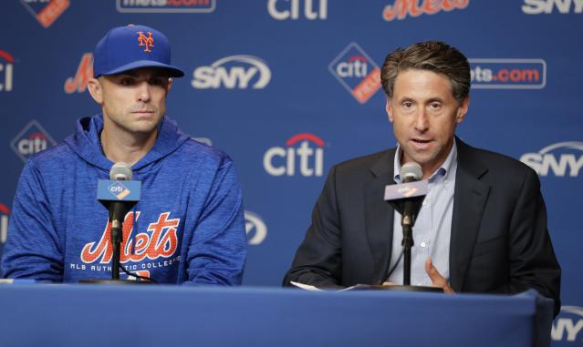 New York Mets owner Jeff Wilpon, right, speaks as third baseman David Wright listens during a news conference before a baseball game against the Miami Marlins Thursday, Sept. 13, 2018, in New York. (AP Photo/Frank Franklin II)