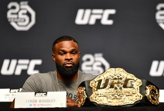 "UFC welterweight champ <a href=""https://sports.yahoo.com/tyron-woodley-admonishes-president-trump-203506991.html"" data-ylk=""slk:Tyron Woodley;outcm:mb_qualified_link;_E:mb_qualified_link"" class=""link rapid-noclick-resp yahoo-link"">Tyron Woodley</a> interacts with the media during a UFC press conference inside the Orpheum Theater on Aug. 3, 2018, in Los Angeles, California. (Getty Images)"