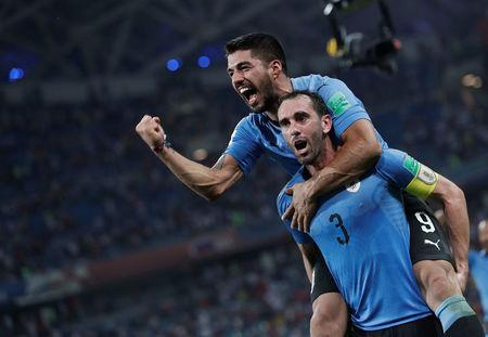 Soccer Football - World Cup - Round of 16 - Uruguay vs Portugal - Fisht Stadium, Sochi, Russia - June 30, 2018 Uruguay's Diego Godin and Luis Suarez celebrate after the match REUTERS/Murad Sezer