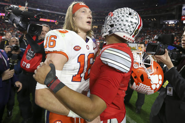 Clemson quarterback Trevor Lawrence (L) and Ohio State quarterback Justin Fields meet after the Fiesta Bowl in 2019. (AP Photo/Ross D. Franklin)