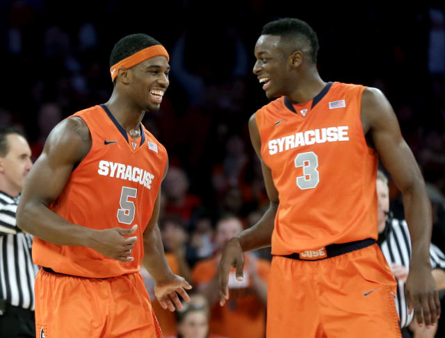 Syracuse's C.J. Fair, left, celebrates with Jerami Grant near the end of the second half of an NCAA college basketball game, Sunday, Dec. 15, 2013, in New York. Syracuse won 68-63. (AP Photo/Seth Wenig)