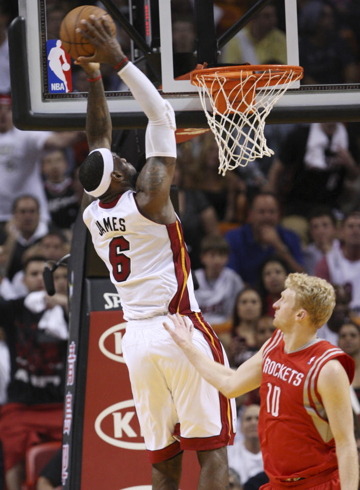 Miami Heat forward LeBron James (6) dunks the ball against Houston Rockets forward Chase Budinger (10) during the second half of an NBA basketball game, Sunday, April 22, 2012, in Miami. James had 32 points and eight rebounds as the Heat won 97-88. (AP Photo/Wilfredo Lee)