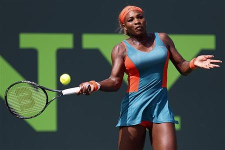 Mar 24, 2014; Miami, FL, USA; Serena Williams hits a forehand against Coco Vandeweghe (not pictured) on day eight of the Sony Open at Crandon Tennis Center. Williams won 6-3, 6-3. Geoff Burke-USA TODAY Sports