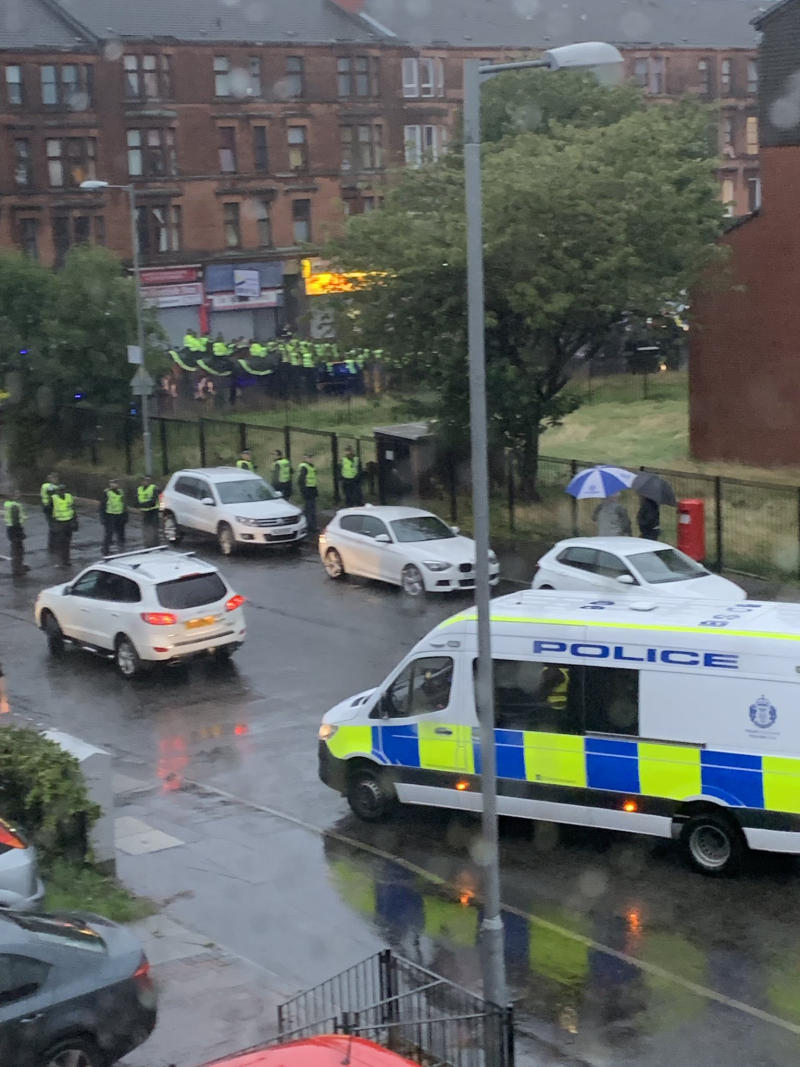 Govan Road in Glasgow was blocked by police as trouble flared following a Irish unity march and counter protest (Picture: PA)