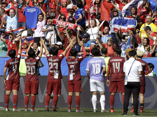 Thailand's players celebrate in front of their supporters after the Women's World Cup Group F soccer match between Sweden and Thailand at the Stade de Nice in Nice, France, Sunday, June 16, 2019. Sweden defeated Thailand by 5-1. (AP Photo/Claude Paris)