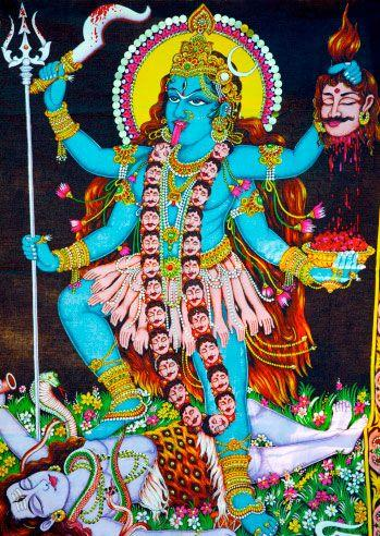 Image of Goddess Kali stepping on her consort Shiva's body as he protects the earth from her wild dance. Photo: Getty