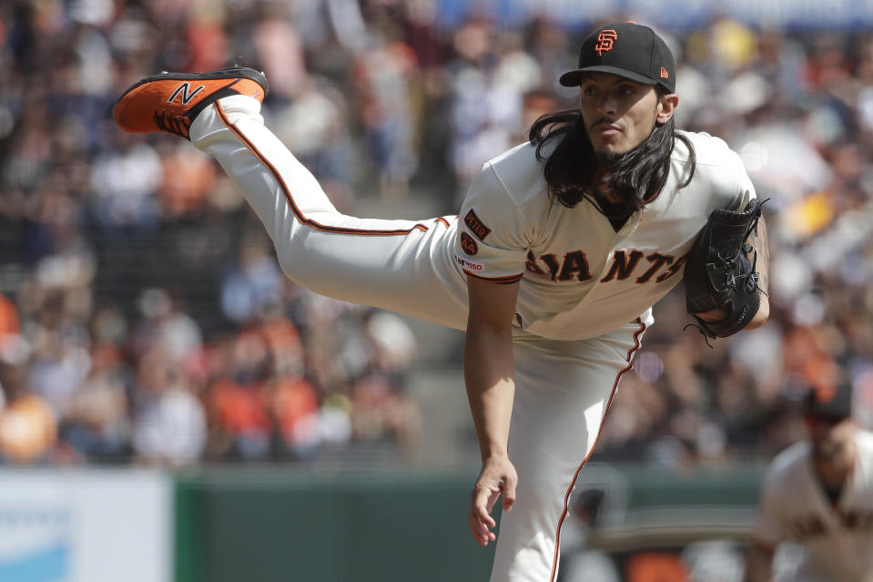 San Francisco Giants pitcher Dereck Rodriguez throws to a Los Angeles Dodgers batter during the first inning of a baseball game in San Francisco, Sunday, Sept. 29, 2019. (AP Photo/Jeff Chiu)