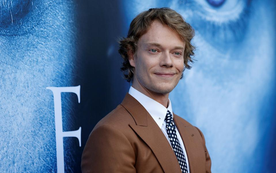 """Cast member Alfie Allen poses at a premiere for season 7 of the television series """"Game of Thrones"""" in Los Angeles, California, U.S., July 12, 2017. REUTERS/Mario Anzuoni"""