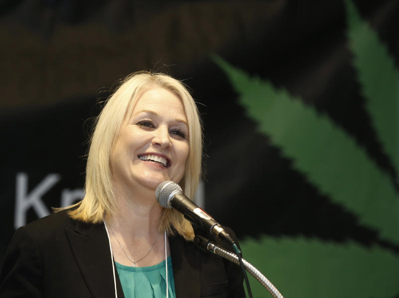 FILE - In this Sept. 28, 2017 file photo California top state pot regulator Lori Ajax addresses an industry group meeting in Long Beach, Calif. California auditors have found that the agency overseeing the state's vast legal marijuana market is understaffed and struggling to do the job. A Finance Department audit in early July 2019 finds that about two-thirds of the Bureau of Cannabis Control's authorized positions remain unfilled. (AP Photo/Damian Dovarganes, File)