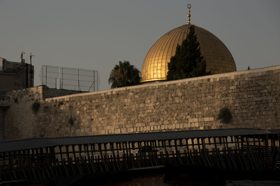 The Dome of the Rock mosque is seen above the Mughrabi Bridge, a wooden pedestrian bridge connecting the wall to the Al Aqsa Mosque compound, in Jerusalem's Old City, Tuesday, July 20, 2021. The rickety bridge allowing access to Jerusalem's most sensitive holy site is at risk of collapse, according to experts. But the flashpoint shrine's delicate position at ground-zero of the Israeli-Palestinian conflict has prevented its repair for more than a decade. (AP Photo/Maya Alleruzzo)