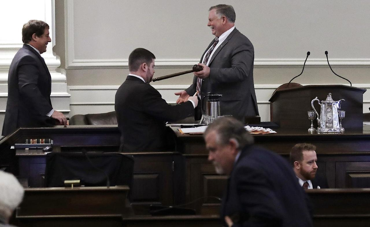 New Hampshire Speaker of the House Shawn Jasper, right, hands the gavel to N.H. Rep. Frank Sapareto, R-Derry, so he could vote from his seat in the chamber at the State House in advance of voting on right to work legislation in Concord, N.H., Thursday, Feb. 16, 2017. House lawmakers have killed the union-targeting legislation after a Republican-on-Republican debate. The outcome marks a defeat for Republican Gov. Chris Sununu, who called right to work a top priority and had urged members of his party to get in line. (AP Photo/Charles Krupa)