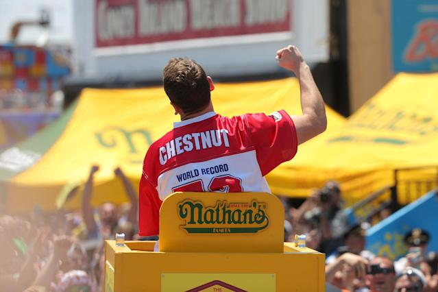 <p>Joey Chestnut is carried to the stage before competing in and winning Nathan's Famous Fourth of July International Hot Dog-Eating Contest at Coney Island in Brooklyn, New York City, U.S., July 4, 2017. (Andrew Kelly/Reuters) </p>