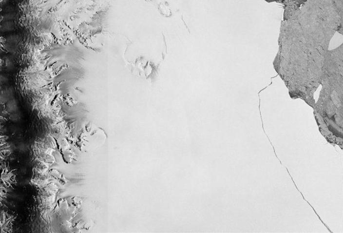 An iceberg section measuring about 6,000 sq. km. broke away as part of the natural cycle of iceberg calving off the Larsen C ice shelf in Antarctica in this satellite image released by the European Space Agency on July 12, 2017. (Photo courtesy ESA/Handout via Reuters)