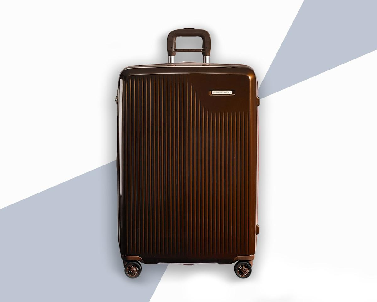 "<p>One problem with hard shell luggage? There's very little wiggle room when you're packing. Thankfully this large, expandable spinner from Briggs & Riley gives you that much-needed extra room to stuff in all those <a href=""https://www.cntraveler.com/story/a-practical-guide-to-getting-all-your-souvenirs-home?mbid=synd_yahoo_rss"">souvenirs you accumulated on the road</a>.</p> <p><strong>Buy Now:</strong> $699, <a href=""https://click.linksynergy.com/deeplink?id=mcB7N8bf3MY&mid=1237&u1=hardshellluggage&murl=https%3A%2F%2Fshop.nordstrom.com%2Fs%2Fbriggs-riley-sympatico-30-inch-expandable-wheeled-packing-case%2F4670874"" rel=""nofollow"">nordstrom.com</a></p>"