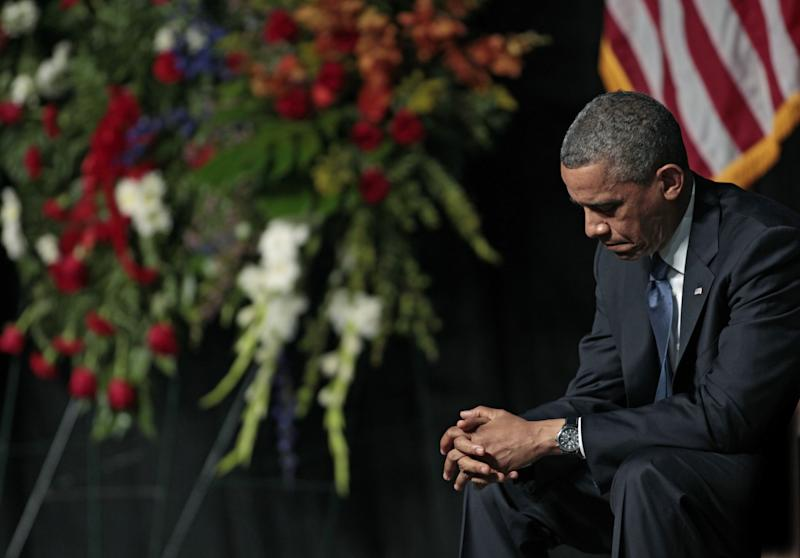 President Barack Obama bows his head at the West memorial service held at Baylor University April 25, 2013 in Waco, Texas.(Photo: Erich Schlegel/Getty Images)