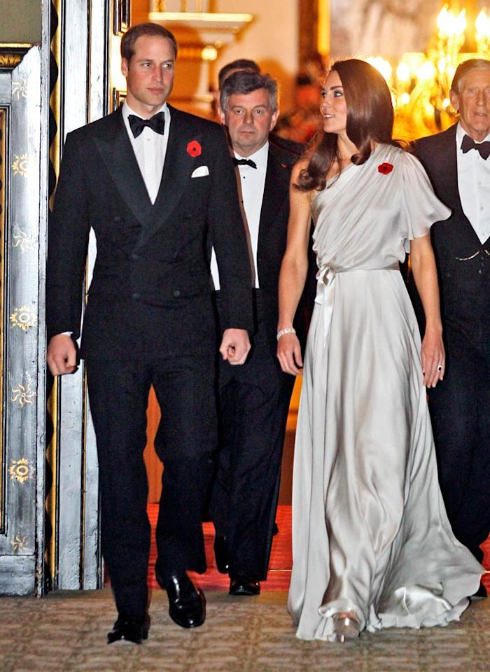 The Duke and Duchess of Cambridge looked smashing as they hosted a charity reception at St. James Palace in London late last week. Prince William donned a standard double-breasted tux, while his gorgeous wife Kate opted for a Grecian-inspired satin gown, courtesy of Brit designer Jenny Packham. (11/10/2011)
