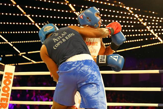 <p>Emmanuel Etienne (red gloves) clobbers David Thompson with a ring during a Heavyweight bout in the NYPD Boxing Championships at the Hulu Theater at Madison Square Garden on March 15, 2018. (Gordon Donovan/Yahoo News) </p>