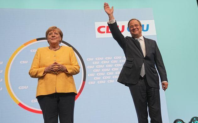 21 August 2021, Berlin: Armin Laschet, candidate for chancellor of the CDU/CSU, federal chairman of the CDU and state premier of North Rhine-Westphalia, stands next to Chancellor Angela Merkel (CDU) on stage at the central campaign kick-off of the CDU and CSU. With the event at the Tempodrom, the Union wants to start the hot phase of the campaign for the 2021 federal election. Photo: Michael Kappeler/dpa (Photo by Michael Kappeler/picture alliance via Getty Images) (Photo: picture alliance via Getty Images)