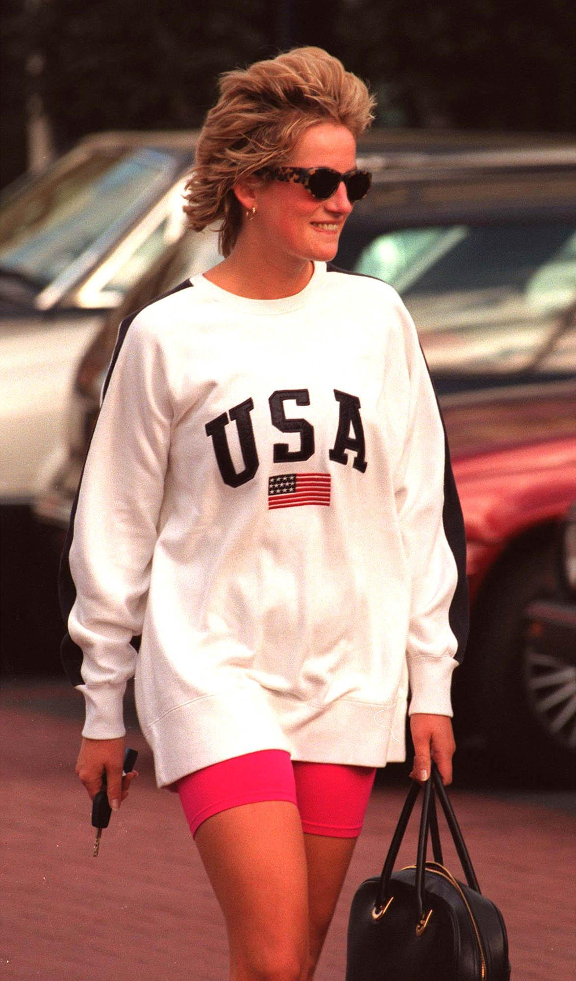 The late Princess of Wales wore the 'USA' sweatshirt at Chelsea Harbour Club in 1997. (Getty Images)