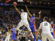 <p>Michigan's Charles Matthews (1) goes to the basket past Florida's Jalen Hudson (3) during the first half of a second round men's college basketball game in the NCAA Tournament, in Des Moines, Iowa, Saturday, March 23, 2019. (AP Photo/Nati Harnik) </p>