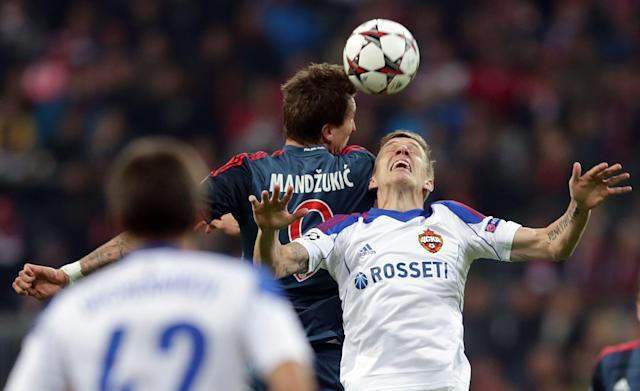 Moscow's Pontus Wernbloom, right, and Bayern's Mario Mandzukic of Croatia challenge for the ball during their Champions League first round group D soccer match between FC Bayern Munich and CSKA Moscow, in Munich, Germany, Tuesday, Sept. 17, 2013. (AP Photo/Matthias Schrader)