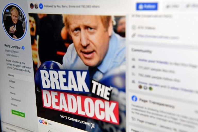 A photo illustration shows the Facebook page of Britain's Conservative Party leader and Prime Minister Boris Johnson