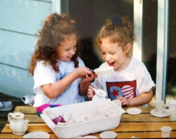PHOTO: Alex and Jaci Hermstad play with their tea set on their deck at home in Storm Lake, Iowa, in 1997. (Courtesy Lori Hermstad)
