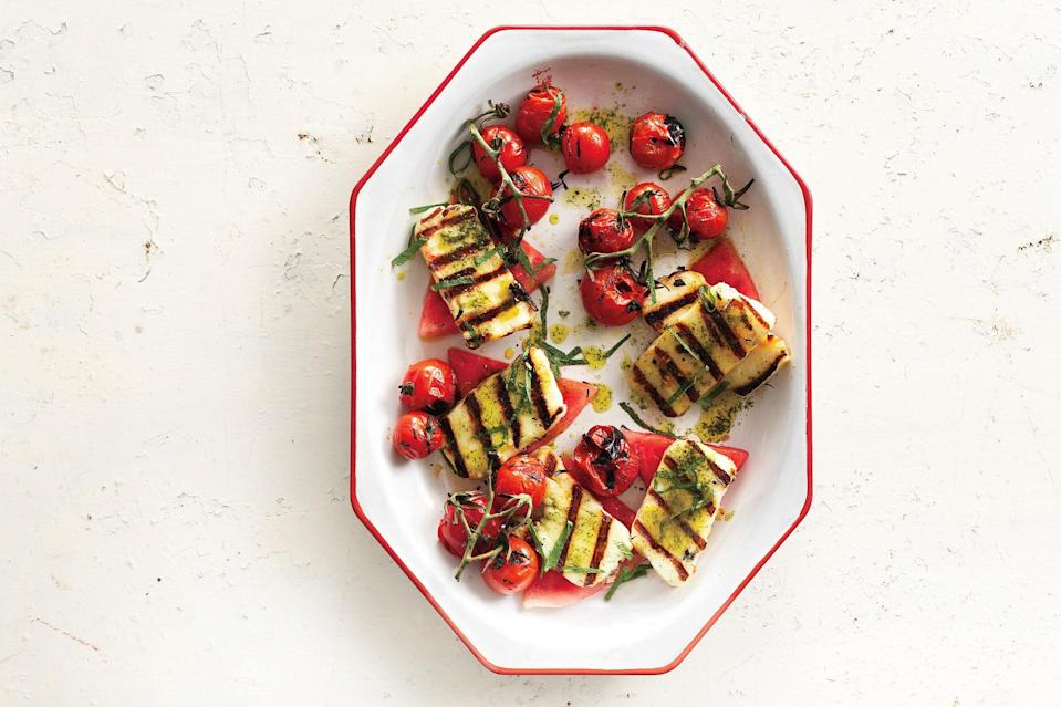 """Cherry tomatoes—grilled on the vine and drizzled with fragrant basil-mint oil—burst with flavor alongside salty grilled Halloumi cheese and crisp, cool watermelon. <a href=""""https://www.epicurious.com/recipes/food/views/grilled-halloumi-with-watermelon-and-basil-mint-oil-366430?mbid=synd_yahoo_rss"""" rel=""""nofollow noopener"""" target=""""_blank"""" data-ylk=""""slk:See recipe."""" class=""""link rapid-noclick-resp"""">See recipe.</a>"""