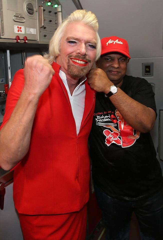PERTH, AUSTRALIA - MAY 12:  Sir Richard Branson and Tony Fernandes pose before their flight to Kuala Lumpur at Perth International Airport on May 12, 2013 in Perth, Australia. Sir Richard Branson lost a friendly bet to AirAsia Group Chief Executive Officer Tony Fernandez after wagering on which of their Formula One racing teams would finish ahead of each other in their debut season of the 2010 Formula One Grand Prix in Abu Dhabi and that the loser would serve as a female flight attendant on board the winner's airline.  (Photo by Paul Kane/Getty Images)