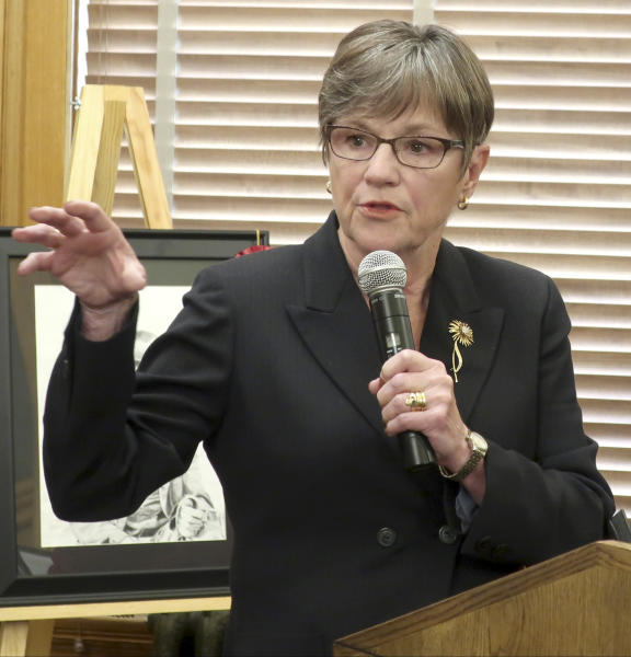 Kansas Gov. Laura Kelly discloses that she's ending a policy that allowed several thousand adults to continue receiving food assistance even though they failed to comply with work requirements, during a news conference, Thursday, July 11, 2019, at the Statehouse in Topeka, Kansas. The Democratic governor's administration enacted the policy in May but top Republican lawmakers argued it violated state law and GOP Attorney General Derek Schmidt threatened to file a lawsuit challenging it. (AP Photo/John Hanna)