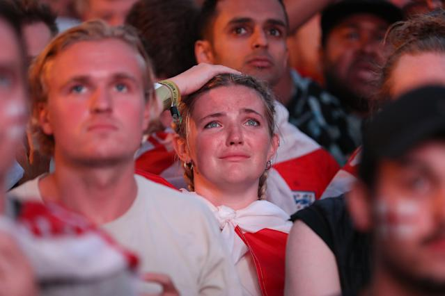 <p>England supporters in Flat Iron Square in London react as they watch the 2018 World Cup semi-final between England and Croatia in Moscow on July 11, 2018. (Photo by Daniel LEAL-OLIVAS / AFP) (Photo credit should read DANIEL LEAL-OLIVAS/AFP/Getty Images) </p>