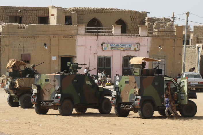 French Barkhane forces patrol the streets of Timbuktu, Mali, Wednesday Sept. 29, 2021. Many residents of Timbuktu are worried that when French troops pull out of the city in northern Mali, jihadis will return to impose strict Shariah law including public whippings and amputations. The Islamic extremists ruled Timbuktu in 2012 and banned music, sports and destroyed historic mausoleums, saying they were idolatrous. (AP Photo/Moulaye Sayah)