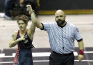 FILE - In this Saturday, Feb. 24, 2018 file photo, a referee raises the arm of Mack Beggs of Euless Trinity after he defeated Chelsea Sanchez of Morton Ranch to defend the Class 6A girls 110-pound title during the UIL State Wrestling Championships at the Berry Center in Cypress, Texas. Texas limits transgender athletes to teams conforming with the gender on their birth certificate. That law came under criticism in 2017 and 2018, when transgender male Beggs won state titles in girls' wrestling competitions after he was told he could not compete as a boy. (Jason Fochtman/Houston Chronicle via AP)