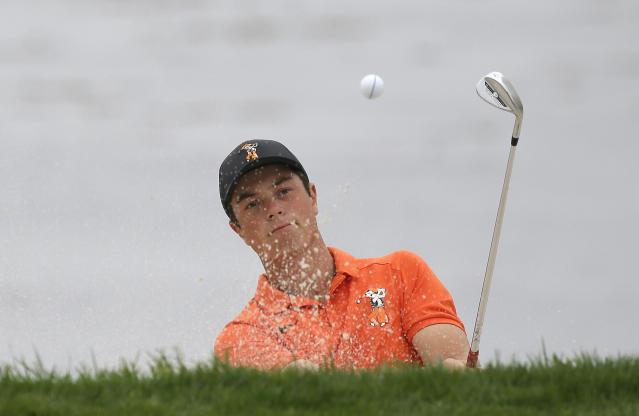 Viktor Hovland, of Norway, follows his shot out of a bunker up to the 18th green of the Pebble Beach Golf Links during the final round of the USGA Amateur Golf Championship against Devon Bling, Sunday, Aug. 19, 2018, in Pebble Beach, Calif. (AP Photo/Eric Risberg)